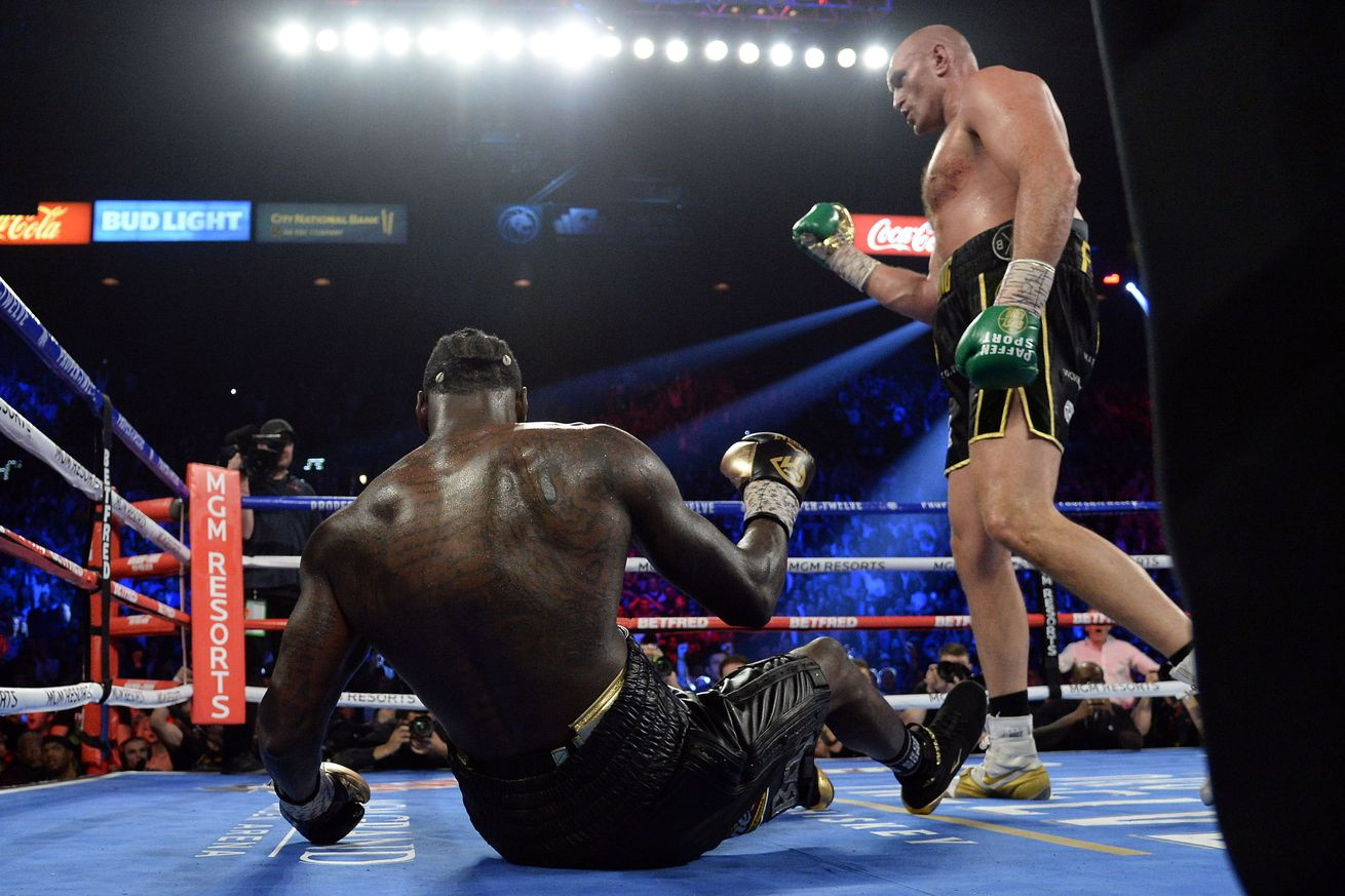 Tyson Fury beating Deontay Wilder